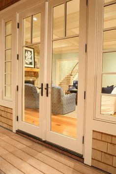 add windows on sides to re-center double doors