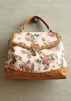 loving feeling floral bag  $44.99  A delicate rose print adds modern romance to this peach canvas purse accented with tan leatherette details, gold colored hardware, and a spacious interior pocket with a zipper closure. Optional shoulder strap. - black leather bag sale, big leather bags, side bags ladies *ad