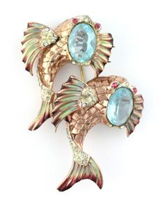 1940s Coro Craft, rare, sterling silver double fish pin with large aqua faceted stones, pink and diamante accents, and enameling. The pin comes off and can be worn as fur clips.