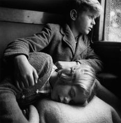 """Thomas and Juliette Kandó in the trainfrom Paris to the Vendée, France (1952)"""