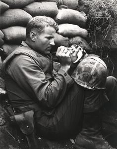"A US Marine feeds an orphan kitten found after a heavy mortar barrage near ""Bunker Hill"" during the Korean War. (Photo by Sgt Martin Riley/Getty Images). 1953 my two favorite things! Marines and kittens"