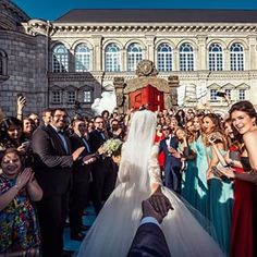 Natalia Zakharova, his wife, also uploaded a picture to her Instagram, leading Osmann through their friends and family. | This Dude Who Follows His Girlfriend Around The World Just Posted Their Stunning Wedding Photos