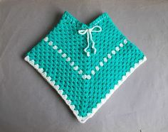 Easy Toddler Crochet Poncho  I would like to point out that this is not my design - this traditional way of crocheting a ponch...