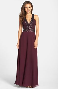 Burgundy sequin gown  | Formal dresses for fall wedding guests. This with less cleavage would be fantastic