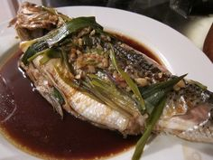 Steamed seabass drizzled with savory soy sauce