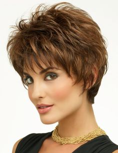 Kitana by Envy is spunky, textured and exhibits layers galore! With its tapered extended nape Kitana offers a soft hugging neckline. Razored edges that frame the face give that deconstructed styling for today's concious women. #kitanaenvywigs #shortwigs