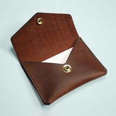 """Leather Single Snap Wallet - Built and designed for your essentials, this hand stitched wallet is secured with a brass button and fits comfortably in your pocket.  Handcrafted in Toronto, Canada.  Boomer Brown Leather  Size: 4.25"""" x 3.125""""   #leather #wallet #brass #fashion #cardholder"""