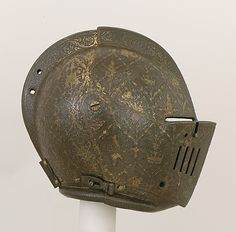 Close-Helmet for the Tournament on Foot, ca. 1600–1610 - the Master of the Castle Mark (Milan, active ca. 1590–1620) This helmet comes from a garniture made by the Maestro dal Castello (castle mark found at the top of the breastplate). He was probably a follower of the great Milanese armorer Pompeo della Cesa (recorded 1572–1593). Among the patrons of the Maestro dal Castello were the dukes of Savoy and King Philip III of Spain. The helmet for the tournament is from an unidentified…