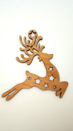 CHRISTMAS ORNAMENT Laser Cut Cherry wood Leaping by HeroandMuse