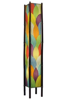 A simple and stunning lamp with real Cocoa leaves and sturdy bamboo legs. Fossilized cocoa leaves are handplaced and laminated on to a standard UL lamp backing, creating each of the four sides of the lamp. The panels are handstitched onto a powder coated, wrought iron frame to form a square design. Shown here in multi-color
