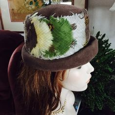 Vintage Hat ~Taupe Wool Felt Cuffed Hat w Feathers LAURA DEB ~ PARIS ~ NEW YORK. Beautiful vintage taupe wool felt cuffed hat encircled w/soft yellow, olive green, cream & brown feathers secured by taupe netting. Matching taupe felt tied bows highlight the back of this hat. In very good vintage condition except for a tiny worn patch underneath the rim. (See pic.) Mannequin for display only & not reflective of how your hat will fit.  Please measure your head before ordering. Inside…