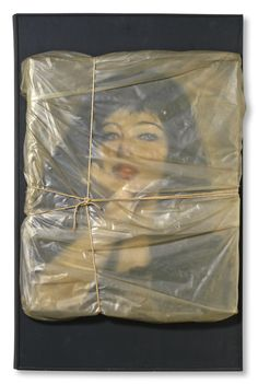 Wrapped Portrait of Jeanne-Claude  1963 Oil on canvas portrait by Christo Javacheff, wrapped with polyethylene & rope by Christo, mounted on black wooden board  Collection David C. Copley (Promised gift to the Museum of Contemporary Art, San Diego, USA)