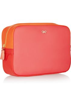 Love this bright Anya Hindmarch cosmetics case!