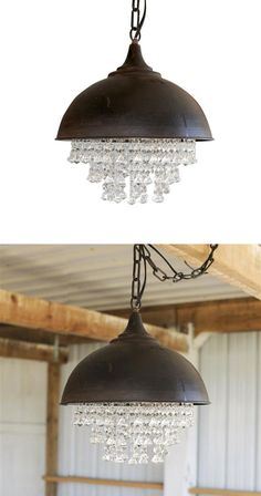 Where rustic meets romance: a perfect juxtaposition of metal and lovely crystals. We love the way these two materials come together to cast pretty light in any room.  Find the Crystal Rock Chandelier, as seen in the Rustic Luxe in Park City Collection at http://dotandbo.com/collections/rustic-luxe-in-park-city?utm_source=pinterest&utm_medium=organic&db_sku=CCO0295