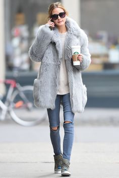 Olivia Palermo with Starbucks and a grey fur coat