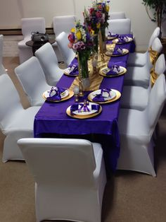 Purple and gold. Fabric covered wall