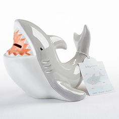 Functional yet fun, Baby Aspen's Ceramic Shark Bank is a great shark themed gift that will look adorable in any nursery or child's bedroom. Plus, this unique coin bank is distinct keepsake for storing baby's first money gifts.
