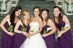 Abbey's bridesmaids are perfect in plum  Rent the Watters Mulberry, Mahogany & Pine gowns from Vow To Be Chic.