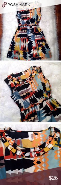 """Aztec Pattern Colorful Dress This funky dress has trendy patterns but a classic cut and ruffle collar to add that finishing touch.   Pit to pit 17""""  Waist 12""""  Shoulder to hem 34""""  100% polyester Used but great condition Francesca's Collections Dresses Mini"""