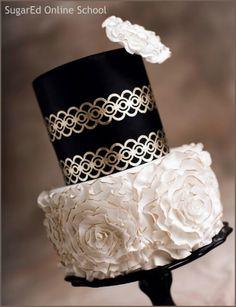 Gold leaf lace and fondant rosettes cake