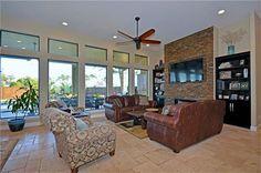 Wall of windows, large fireplace and open floor plan 199 Mcallister Rd, Bastrop, TX 78602