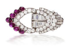 An art deco diamond and ruby brooch, Van Cleef & Arpels, French, 1930  of lozenge-shaped outline and openwork design, detailed with old European, baguette and rectangular-cut diamonds, further accentuated by seven oval-shaped cabochon rubies; signed Van Cleef & Arpels, no. 33297, with French assay marks and maker's mark; estimated total diamond weight: 5.40 carats; mounted in platinum; width: 1 7/8in.