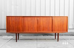 Large Danish modern mid century teak credenza / sideboard attributed to Gunni Omann.