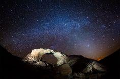 A shooting star and the night sky shining above Arscenic Arch, near Poison Springs Canyon in Utah.  by Dan Ransom.