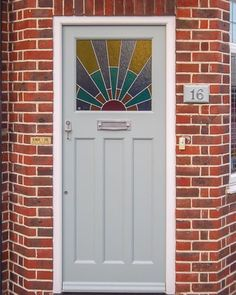 Front Door With Art Deco Sunrise Leaded Glass And External Doors Bespoke period wooden,Victorian Edwardian and Georgian style Front doors and Sash windows,Supplied and fitted across London and the home counties Art Deco Door, 1930s Doors, Glass Front Door, Victorian Front Doors, External Doors, Front Door, Wooden Panelling, Leaded Glass, Garage Door Types