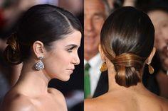 Nikki Reed's elegant looped, side-part, sleek bun hairstyle | allure.com