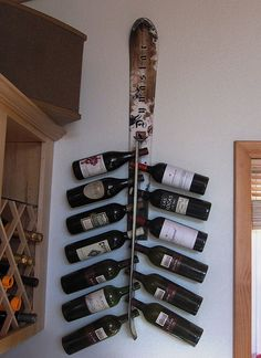 A Wall Mounted Snow Ski Wine Rack holds 13 Bottles of your favorite wine. Created from recycled Snow Ski's and created in USA
