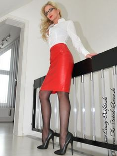 Heike - Fetish Queen in  red Leather Skirt and High Heeled Shoes.