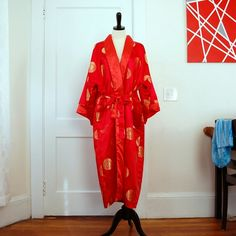 Luxurious Soft Sati Reversible Red Gold Robe Luxuriously soft satin. The robe is reversible- One side is red with gold emblems, the other side is a red/salmon color with a beautifully embroidered dragon on the back. The belt is also reversible. Both sides have pockets. Eastern Collection Intimates & Sleepwear Robes