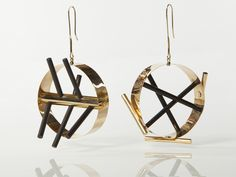 Ettore Sottsass, Untitled, circa 2000, earrings, 18-karat gold, ebony rods, produced in an edition of nine by Cleto Munari, height 110 mm, 60 mm diameter, photo: Didier Ltd