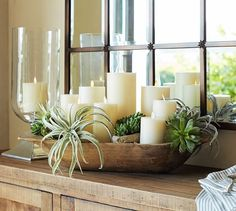Dough bowl with candles and plants