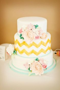 Gold Chevron - This is a design by Erica Obrien, fell in love with her cake when I was given a picture of it to copy. This cake was several firsts for me. The first time I've made gumpaste flowers...LOVED making them! This is the biggest cake I've made so far (wow, was it heavy) and also the first time I've used SMBC under fondant and I was quite disappointed in how the fondant ended up looking (not very smooth and had several air bubbles). I guess I need to become more familiar with working…