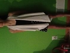 DIY vest out of old tshirt  Cut of sleeves neck and down both sides no sewing or glue