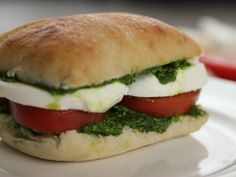Tomato, Mozzarella and Pesto Sandwiches : Four ingredients and five minutes — that's all it takes to prep Ree's top-rated sandwiches. Follow Ree's lead and start with prepared pesto for a fuss-free lunch.