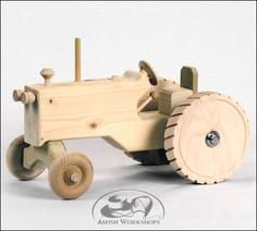 Here is a tractor any farmer would be proud to own. Just think of all the plowing! Not to mention the bushel of other farm jobs that beg for a tractor. 10 L x 5 W x 6 H This tractor is made in the USA. Wooden Toy Farm, Wooden Truck, Making Wooden Toys, Handmade Wooden Toys, Learn Woodworking, Woodworking Projects, Farm Toys, Wood Toys, Toys For Boys