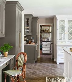 C.B.I.D. HOME DECOR and DESIGN: KITCHEN TRENDS - love the floors, the bistro chair, the mix of white and grey/taupe cabinets.