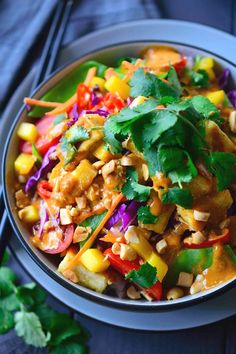 This Thai Buddha bowl is quick and easy to put together with heaps of fresh vegetables and crispy fried tofu served over coconut rice and topped off with a simple Thai peanut sauce with spicy red curry. Great for a weeknight dinner, these bowls come together in just 15 minutes!