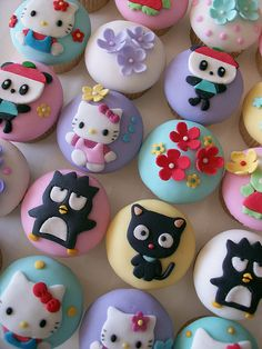 Adorable cupcake fondant work. Hello Kitty and friends.