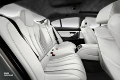 Drivers and Passengers are entirely at one with the sensual interior design: BMW Individual full fine-grain Merino leather in Opal White, Alcantara roofliner in Anthracite and interior trim Piano finish Black.