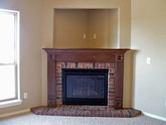 I love the feel of this corner fireplace with television nook. I would prefer stone or tile versus the brick though.