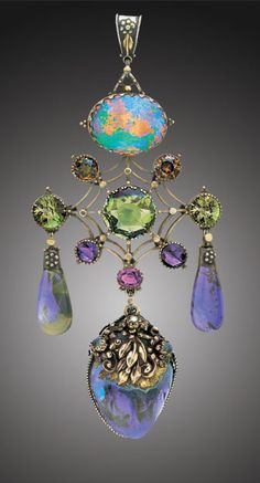 Artificier's Guild pendant, ca. 1910, gold and silver with opal, sapphire, zircon, tourmaline, amethyst, almandine garnet, moonstone and pearl | Via Tadema Gallery, Stock code 4351.