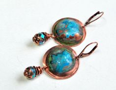 """Solid copper forged to bobbles then patina added ~ Crystal Drops pull the blue from the patina and have great sparkle! Antique Copper earwires (base metal) Approx 2"""" long Bandana Girl Originals by Melinda Orr All jewelry comes boxed with bandana ribbon"""