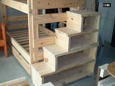 Bunk bed with stairs, which could be used for storage. I would prefer another vertical slat for support.