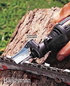 Sharpening a chain saw blade with a Dremel tool and a blade sharpening kit.