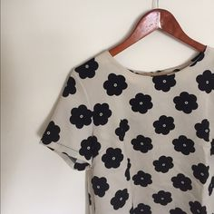 ⚫️ Floral Top ⚫️ Cute flower patterned top. Zipper in back. Size tag has been cut out but it's a Medium. It is loose fit, very sophisticated. 100% polyester  Mandy Evans Tops Blouses