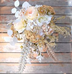 A bouquet that exudes classy in latte, ivory, peach, gold & champagne. For a beautiful  @stefaniemelissa #bride #bouquet #jewelbouquet #broochbouquet #bridebouquet #bridalbouquet #weddingbouquet #wedding #florals #flowers #flowerstagram #weddingflowers #thecoppelia